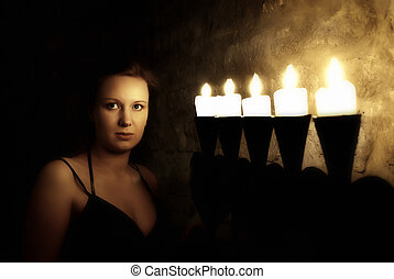 Portrait of young woman in dark mysterious castle
