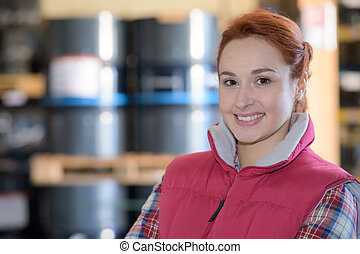 portrait of young woman in factory warehouse