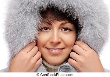 Portrait of young woman in fluffy hood