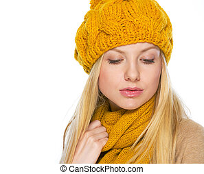 Portrait of young woman in hat and scarf