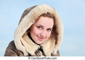 Portrait of young woman in hood