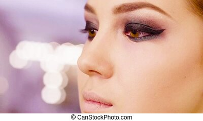 Portrait of young woman in makeup studio
