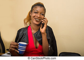 portrait of young woman in office, smiling.