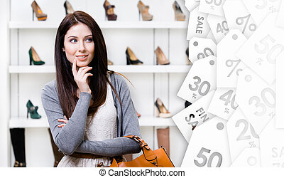Portrait of young woman in shopping center. Clearance sale