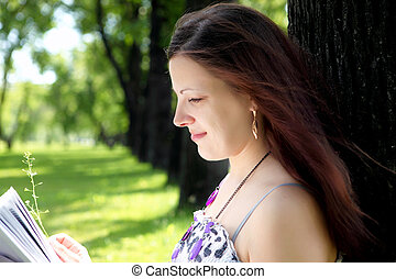 Portrait of young woman in the park