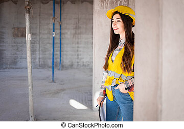 Portrait of young woman inspector at a construction site