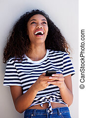 young woman laughing with cellphone