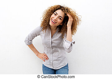young woman laughing with hand in hair