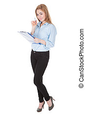 Young Woman Looking At Clipboard