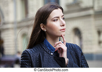 Portrait of young woman on spring street