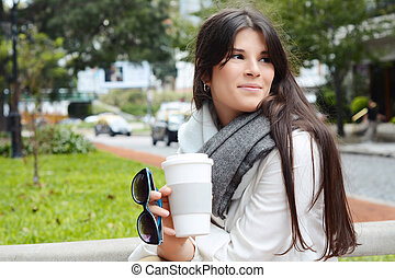 Portrait of young woman, outdoors.