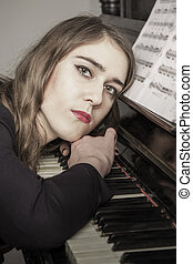 Portrait of young woman pianist