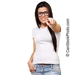 portrait of young woman pointing with finger against a white background