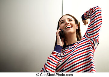 young woman smiling and talking with mobile phone