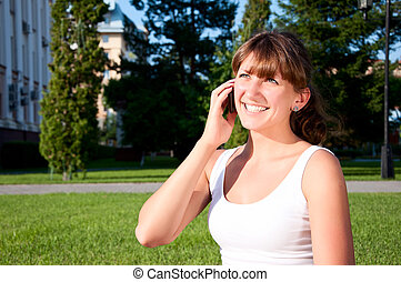 portrait of young woman talking on cell