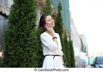 portrait of young woman talking on mobile phone