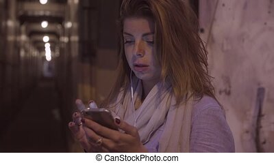 Portrait of young woman taping in smartphone