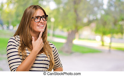 Portrait Of Young Woman Thinking at a park