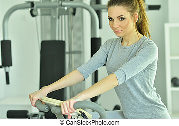 Portrait of young woman training in gym
