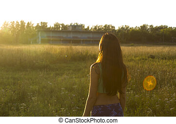 Portrait of young woman watching the sunset