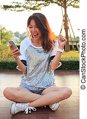 portrait of young woman watching to mobile phone screen with sur