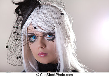 Portrait of young woman wearing blue contact lenses