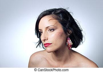 Portrait of young woman wearing earrings