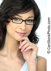Portrait of young woman wearing eyeglasses