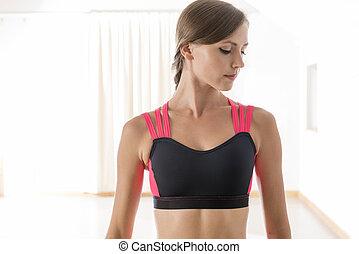 Portrait of Young Woman Wearing Fitness Bra Top in Dance Studio
