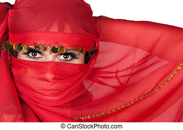 Portrait of young woman wearing traditional red veil