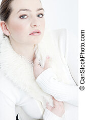 portrait of young woman wearing white sweater