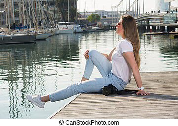 Portrait of young woman which is relaxing at berth