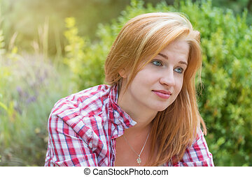 Portrait of young woman with a saddened smile - Saddened ...
