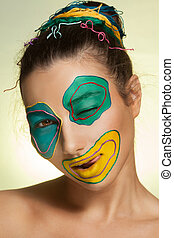 Portrait of young woman with art fashion makeup