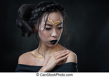 Portrait of young woman with creative hair