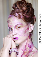Portrait of young woman with creative make-up in spring style