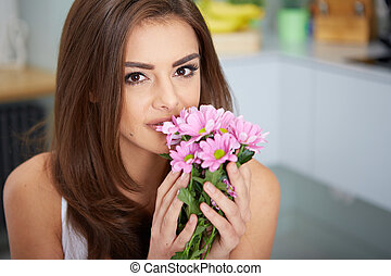 Portrait of young woman with flowers