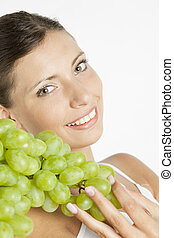 portrait of young woman with grape