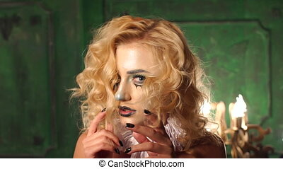 Portrait of young woman with scared halloween make-up.