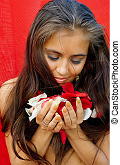 young women holding petals of the roses