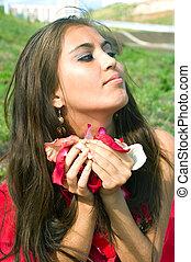 women holding petals