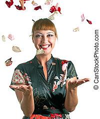 women throws up petals