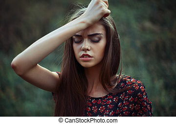 Portrait of young worried woman