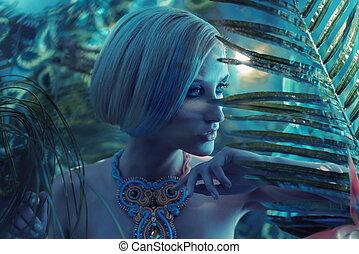 Portrait og a sensual blonde in the tropics