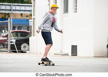 Boy Riding Skateboard