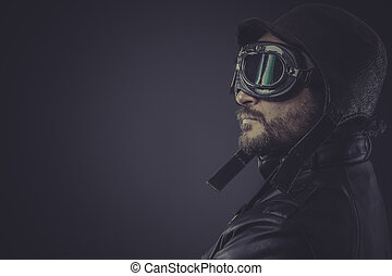 portrait pilot dressed in vintage style leather cap and goggles