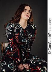 portrait plus size fashion model fat woman on gray studio background, overweight female body.