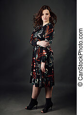portrait plus size fashion model fat woman on gray studio background, overweight female body.