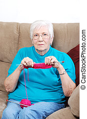 senior woman counting knitting