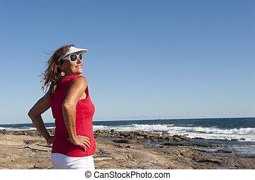 Portrait sexy mature woman ocean